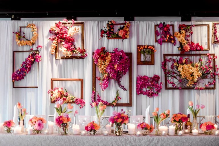 Flower backdrop wedding stylist