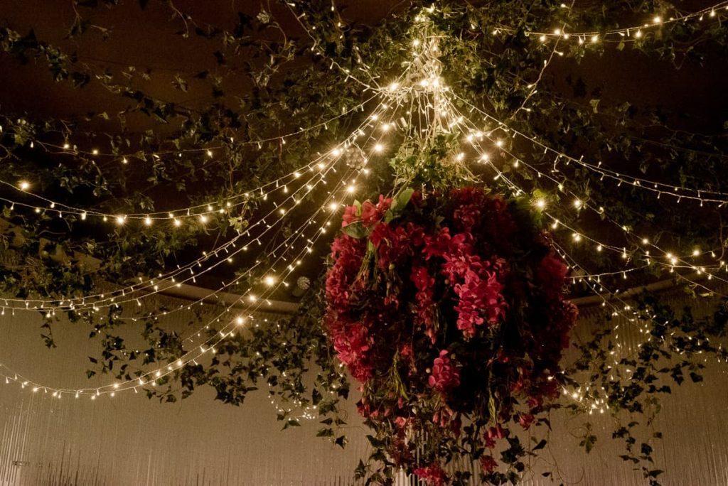 Floral chandelier wedding stylist
